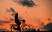 Guy bike sunset pixabay edit